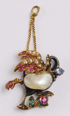 Pendente Settepassi Firenze  argento, oro e pietre con grande perla scaramazza. Fine XIX secolo