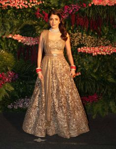 Actor Anushka Sharma and cricketer Virat Kohli, who were married in a private ceremony on December 11 in Italy, held their second wedding reception at St Regis, Mumbai on Tuesday. Several members of t Indian Bridal Outfits, Indian Bridal Fashion, Bridal Dresses, Shadi Dresses, Indian Dresses, Golden Bridal Lehenga, Engagement Dress For Bride, Wedding Attire, Fancy Dress Design