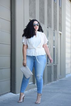 Tanesha Awasthi (also known as Girl With Curves) wearing plus size skinny jeans, lace cardigan and heels.