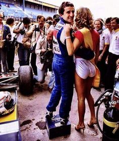Alain Prost taking advantage of his stardom . Seems very pleased.