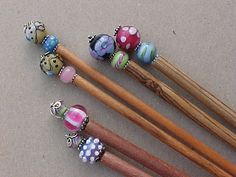 """Lampwork bead knitting needles.  I was thinking of using lampwork beads to decorate hair """"chopsticks"""", but this works too."""