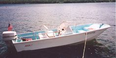 """1971 Whaler 16 Katama Stern Quarter interior   Katama model --16' 7"""" length-- was made from 1968 to 1975 and has a fiberglass console and windshield attached to the starboard side."""