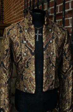 Can be worn as pictured or buttoned across double-breasted style. Antique double headed eagle buttons fasten lapels in front with smaller buttons at each cuff. One inside breast pocket on left side. Fully lined in sleek black satin. Steampunk Couture, Style Steampunk, Steampunk Men, Steampunk Clothing, Steampunk Fashion, Gothic Fashion, Mens Fashion, Fashion Tips, Gothic Trends