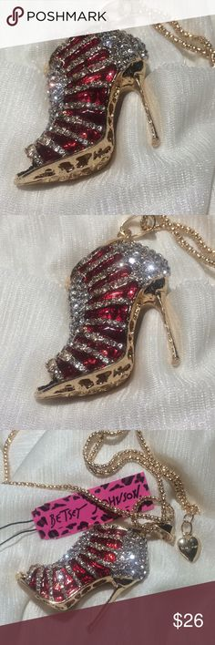 """Betsey Johnson Crystal Stiletto Pendant Necklace Betsey Johnson now gives you the unique opportunity of how to show off your most gorgeous stilettos 👠!  This pendant is shimmering with crystal clear and elegant red rhinestones. The shoe itself is a design of gold color lined completely with crystals. The gorgeous ruby red crystals make the design of a foot that is actually wearing this breathtaking stiletto. Bling is an understatement for this beautiful fashion statement. It has a 28""""…"""