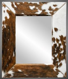 DIY cowhide mirror Cowhide and a good DIY project are two of my favorite things, and these 5 cowhide DIYs are a nice way to bring that all together. Cowhide Decor, Cowhide Furniture, Western Furniture, Rustic Furniture, Cabin Furniture, Furniture Ideas, Furniture Design, Diy Rustic Decor, Country Decor