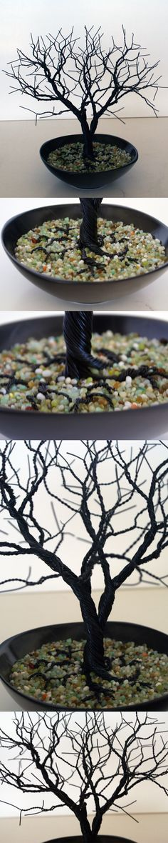 Wire tree cemented in a bowl with green pebbles on top. I had fun with the roots this time.