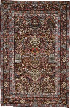 Kirman 'Millefleurs' rug, Southeast Persia approximately 213 by 139cm; 7ft., 4ft. 6in.  circa 1900