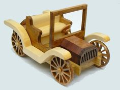 This is a handcrafted replica of an early American made automobile.It has a beautiful blend of 5 local and exotic woods: mahogany,aspen,light walnut,dark walnut and poplar.The 4 wheels and spare were all cut and shaped by me. Usually toymakers(myself included) use pre-bought wheels. This adds