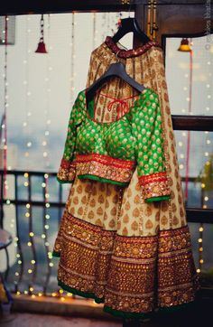 cream lehanga with brown buti and green banarsi blouse by sabyasachi