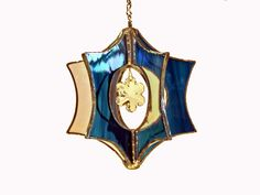 Frosty Blue Snowflake Stained Glass Suncatcher by creationsinglass, $30.00