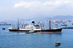 MV Bellerophon of the Blue Funnel Line(Alfred Holt & Co.) at Hong Kong.Built by Caledon Shipbuilding Dundee in 1950, 7,707 Gross Ton. 463 feet long.She traded from Birkenhead,Liverpool,Glasgow & Swansea to the Far East(Malaysia,Singapore,Hong Kong,China,Japan,Indonesia,Borneo & Philipines). 1957 transferred to Glen Line renamed Cardiganshire, 1972 reverted to Bellerophon, 1976 sold to Saudi-Europe Line renamed Obhor.