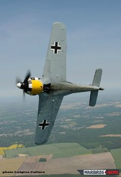 Belly shot of Focke Wulf Fw-190 banking during air to airs over South Virginia. Former Military Aviation Museum a/c released for sale.Here Ray Fowler flying Fw-190 to its new owner,The Tillamook Air Museum.An F-16 pilot in Gulf War,now commercial airline pilot,& still with military on F-16s in Air National Guard.Obviously doesn't like Terra Firma much!