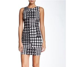 NWT Trina Turk Houndstooth Dress This dress has a great fit. Made from a stretch knit fabric and has full zipper closure on back of dress. Perfect for the nice weather or when it is cold with a blazer! Brand new with tags still attached. Trina Turk Dresses