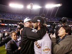 San Francisco Giants manager Bruce Bochy (15) congratulates San Francisco Giants starting pitcher Madison Bumgarner (40) as they win their third World Series in the ninth inning of Game 7 of baseball's World Series against the Kansas City Royals at Kauffman Stadium in Kansas City, Mo., on Wednesday, Oct. 29, 2014. (Josie Lepe/Bay Area News Group)