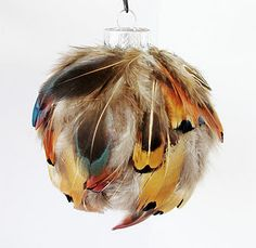 Ah this girl has some super fun crafts...feather ornaments! That would be a fun tree!