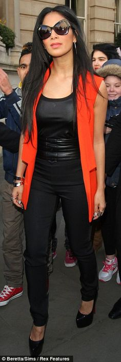Adding a splash of colour to the capital: Nicole Scherzinger brightens up her all black outfit with an orange waistcoat Nicole Scherzinger, All Black Outfit, Celebs, Celebrities, Orange, Business Fashion, Beauty Photography, Leather Fashion, Color Splash