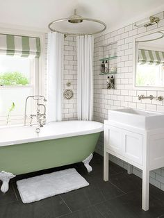 A crisp window dressing, like this Roman shade, makes a bath feel more finished and introduces color and pattern. Window film can provide privacy on the lower sash.