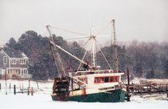 The fishing boat Emma Rose is stuck in ice in Orleans Harbor in Cape Cod, Mass.