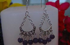 Designed & created by Debe for Debe's Gems.  Earrings are 1.5in in length.  Gorgeous round faceted Amethyst's hung on Sterling silver.  Starting bid is $16.00.  Buy it now for $20.00.  Don't miss out on this pair of earrings.  Share it with your friends.