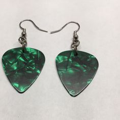 """Pearlescent Green guitar pick earrings. Be the rock star of the party! Many colors to choose from. New. Matching pendant also available. 1 1/4"""" tall x 1"""" wide. Jewelry Earrings"""