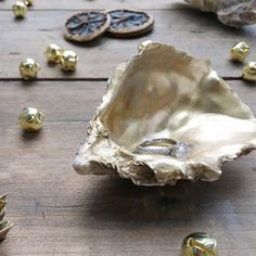 Add some sparkle to your presents for loved ones this Christmas with these super easy oyster shell trinket dishes!