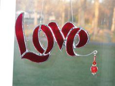 Love stained glass suncatcher. $17.00, via Etsy.