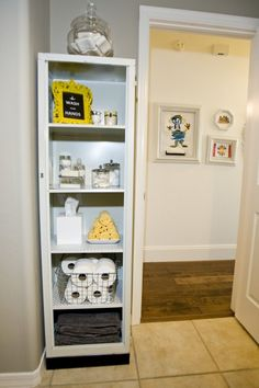 bathroom storage..Great idea!  I never really thought of putting a narrow bookcase in the bathroom for storage!