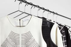 All lined up. Tops from the Fall 2014 Calvin Klein white label.