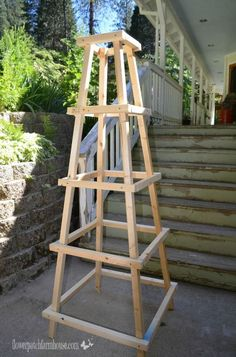 DIY easy garden obelisk. Paint or use protective tung oil. Place in garden. Enjoy Click thru for directions, photos, etc.