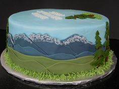 A Cake for an avid outdoorsman.  Some snowcapped mountains.