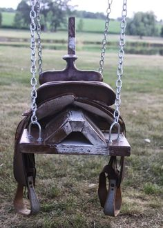 saddle horse swing- would be cute with horse head, mane, and tail! just remove saddle when not in use. Wish I'd kept my saddle! Saddle Swing, Kids Saddle, Saddle Rack, Tire Horse Swing, Saddle Chair, Chair Swing, Boot Rack, Swinging Chair, Outdoor Projects