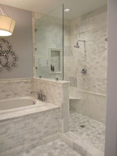 Still loving that Carrara marble tile; would mix it with more rustic wood elements though