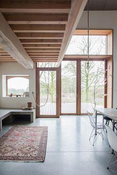 Architect Jeanne Deckers has renovated and extended a traditional Dutch farmhouse featuring an exhibition space, carport and cobbled courtyard.