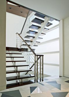 Staircase of the Kowalewski Residence in Atlantic Beach by Belmont Freeman Architects