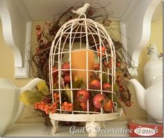 birdcage decorated for fall....the idea i need for the birdcage