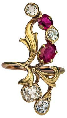 Art Nouveau ruby and diamond ring, circa 1900. This unique Art Nouveau ring is designed as a stylized spray of flowers with green gold chased leaves, set with diamonds and natural rubies.The diamonds are antique cushion cuts and old European cuts. Approximate weight (from bottom to top) - 0.35 ct, 0.80 ct, 0.25 ct, 0.28 ct. Total estimated diamond weight - 1.68 ct.Two natural rubies of good color - approximately 0.72 ct and 0.37 ct - 1.09 ct total weight. The ring was made in Moscow between…