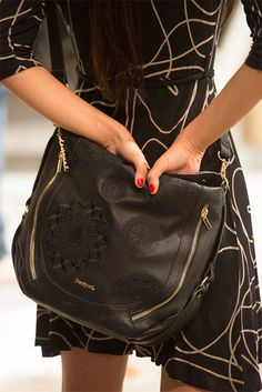 Black bags are always a safe bet, especially when they look this good! With zip and cut-out details this bag has detachable straps and is big enough to carry everything you need this winter! #XmasByDesigual