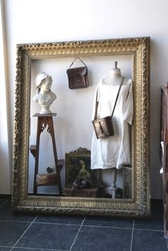 Display inside a large frame. Use my large white frame in storage Hang or stand for wall/clothes display