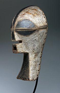 Large Songye Female Kifwebe Mask. D.R.Congo Africa, Lualaba River region, Songye, early 20th century.  An exemplary Kifwebe mask, created by the Songye and worn in association with the Bwadi Bwa Kifwebe secret society.