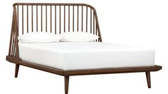 Shop jarvis low profile wood bed.   Both sculptural and comfortable, master bed designed by James Harrison is a dream from any angle.