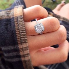 engagement ring with halo http://itgirlweddings.com/5-must-haves-for-the-newly-engaged/