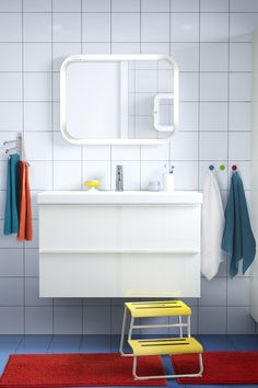 Make room for everyone in your bathroom! Brightly colored IKEA towels and bath mats help to create a bathroom that makes your mornings smile.