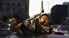 26 août 2014. A Gaza, des enfants palestiniens célèbrent le cessez-le-feu entre Israël et le Hamas après 29 jours de conflit.