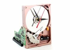 Upcycled Coppertone & Silver Hard Drive Clock and Circuit Board stand Computer Hard Drive, Board Stand, Cool Clocks, Diy Clock, Vintage Cameras, Circuit Board, Cool Items, Second Hand, Deco