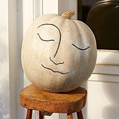 A large white pumpkin plays the part of la lune. Recreate the classic man-in-the-moon look with a simple line drawing.