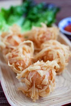 Fried shrimp balls with wonton skin. They're crispy, yummy and make a perfect appetizer. Easy fried shrimp balls recipe with simple ingredients   rasamalaysia.com