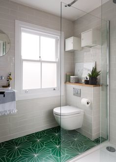 """The green floor tiles from Marrakech Designs (one of Andrew's indulgences) are a great focal point in the bathroom. """"The bathroom floor tiles were shipped over from Sweden so also took quite a bit of time and money, but we love them."""""""