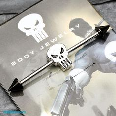The Punisher™ Skull Spike Ends Industrial Barbell