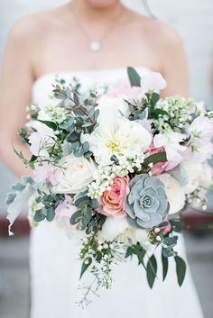 Loft on Lake Bridal Bouquet full of peonies, roses, succulents, lilac and sweet pea.  All of the best Spring flowers! Photo: Codrean Photography
