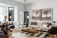 The colour of the chairs, and the short stature of the stools give an airy feel to the room.